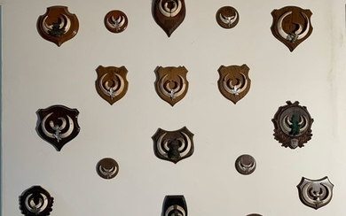 Set of nineteen hunting trophies made up of...