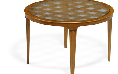 Swedish design: Coffee table with profiled, tapering elm wood legs. Circular top of raw glass with wooden grate below.