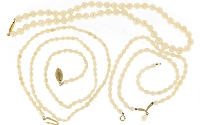 Three single string pearl necklaces including two with