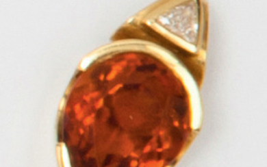 Yellow gold pendant, set with a citrine surmounted...