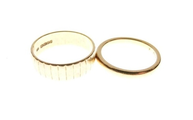 22ct gold wedding band and a textured 18ct gold...