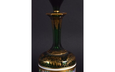 A 19TH CENTURY BOHEMIAN ENAMELLED GREEN GLASS SCENT BOTTLE p...