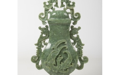 A 20th century Chinese carved jade urn and cover raised on h...