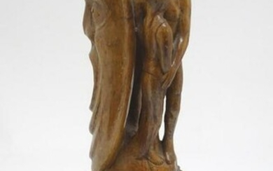 A 20thC carved wooden sculpture titled Tragic Muse to