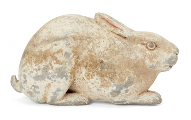 A Chinese grey pottery hare, Han dynasty, modelled crouching facing...