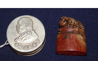 A Chinese silver seal paste box and a soapstone seal...