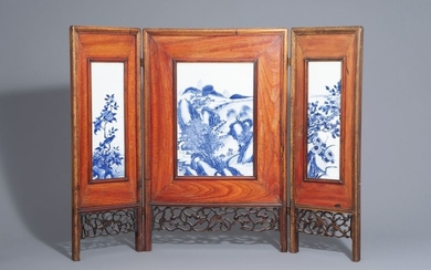 A Chinese threefold wooden screen with blue and...