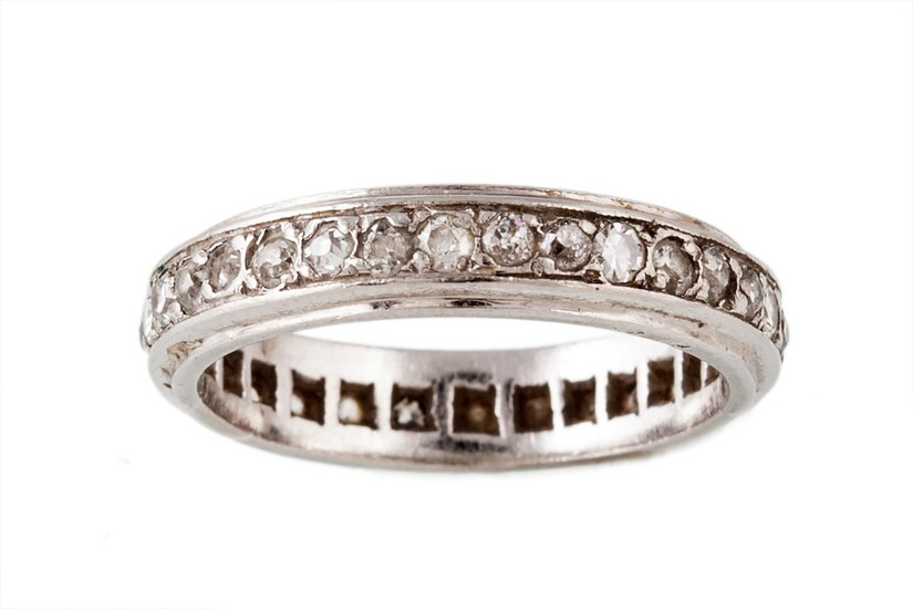 A DIAMOND ETERNITY RING, with old cut diamonds of approx. 1....