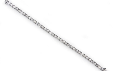 A DIAMOND LINE BRACELET COMPRISING THIRTY-EIGHT ROUND BRILLIANT CUT DIAMONDS TOTALLING 5.20CTS, IN 18CT WHITE GOLD, LENGTH 170MM, 14...