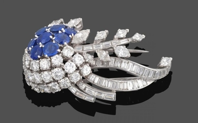 A Diamond and Sapphire Brooch, circa 1950, of stylised floral...