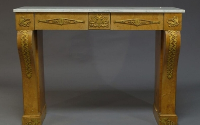 A French Empire style burr walnut and ormolu mounted console...