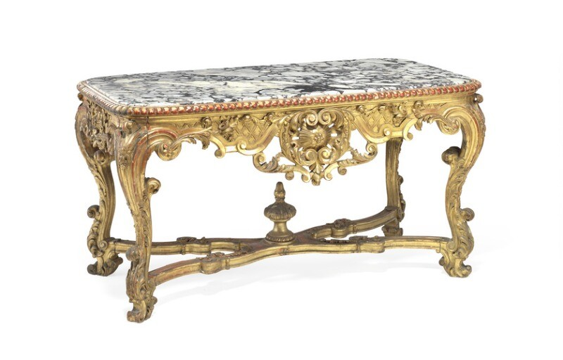 A French Louis XIV style giltwood center table with curved marble top. Late 19th century. H. 79 cm. L. 150 cm. W. 85 cm.