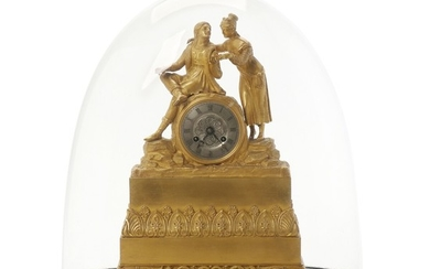 A French figural gilt bronze mantel clock adorned with young couple. Second half of the 19th century. H. 35 cm. W. 24 cm. D. 8,5 cm.