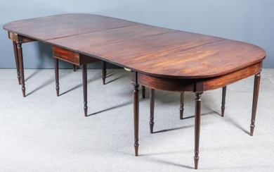 A George III Mahogany Extending Dining Table in Three...
