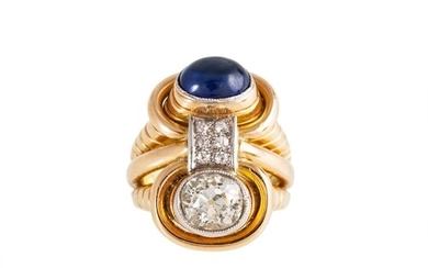 A MID 20TH CENTURY DIAMOND AND SAPPHIRE TWO STONE RING, of r...