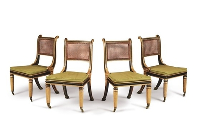 A SET OF FOUR REGENCY GILT AND EBONISED WOOD CANED SIDE CHAIRS IN THE MANNER OF HENRY HOLLAND, EARLY 19TH CENTURY