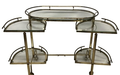 A STYLISH MID 20TH CENTURY BRASS AND GLASS DRINKS TROLLEY T...