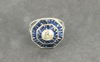 A diamond and sapphire dress ring, octagonal the central...