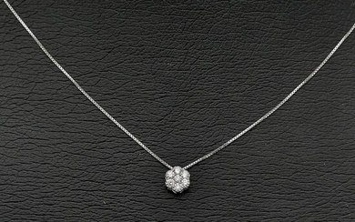 A diamond pendant set with numerous brilliant-cut diamonds weighing a total of app. 0.15 ct., mounted in 18k white gold. Diam. app. 5 mm. L. 42 cm.