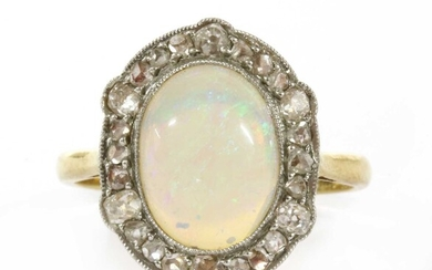A gold opal and diamond ring
