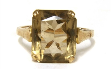 A gold single stone smoky quartz ring
