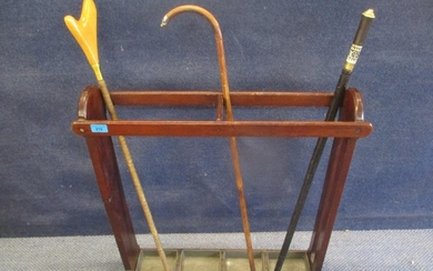 A mahogany umbrella/stick stand with four drip trays, a vint...