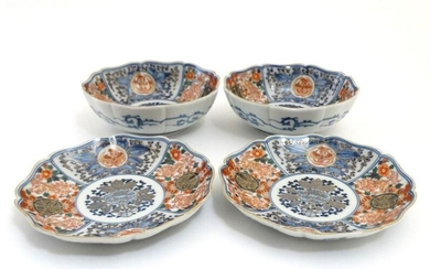 A pair of Japanese Imari plates and matching pair of