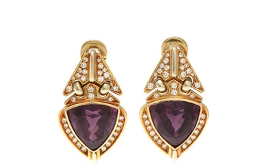 A pair of amethyst and diamond ear pendants each set with a fancy-cut amethyst and numerous brilliant-cut diamonds, mounted in 18k gold and white gold. (2)