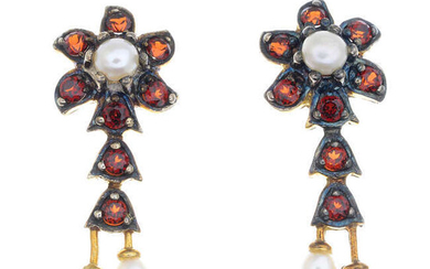 A pair of garnet and seed pearl floral earrings.