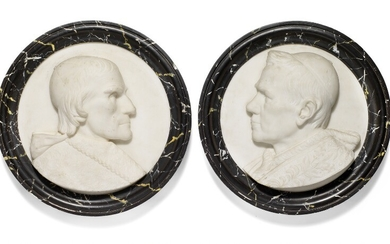 A pair of round Italian Carrara white marble plaques each with portrait of a Pope in profile, profiled marbled frame. Mid-19th century. Diam. 47.5 cm. (2)