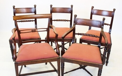 A set of four Regency mahogany dining chairs, each with a ro...