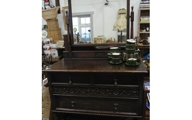 A stunning antique carved oak mirror back dressing table.