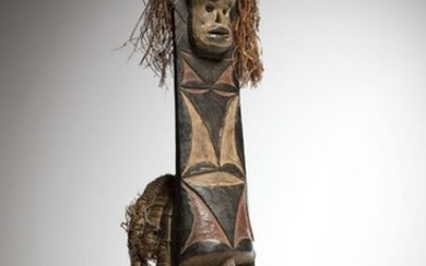AFIKPO, Nigeria. Polychrome mask with a concave face...