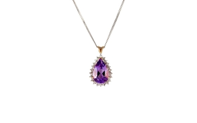 AN AMETHYST PENDANT, the pear shaped amethyst mounted in whi...