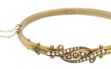 AN ANTIQUE SEED PEARL, PERIDOT AND DIAMOND BANGLE BY DUNKLINGS