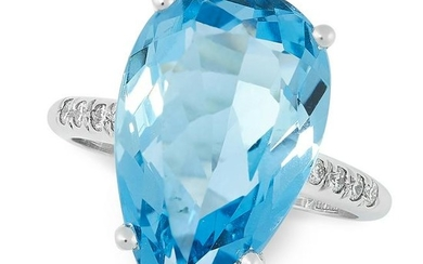 AN AQUAMARINE AND DIAMOND DRESS RING set with a pear