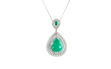 AN EMERALD AND DIAMOND PENDANT AND CHAIN, boxed, with one pe...