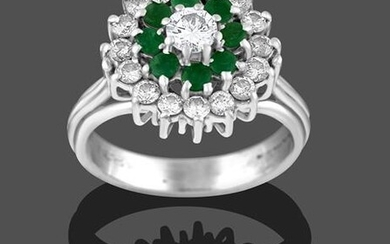 An 18 Carat White Gold Emerald and Diamond Cluster Ring,...