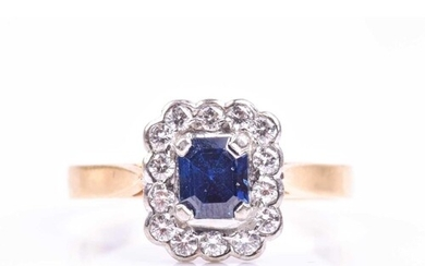 An 18ct yellow gold, diamond, and sapphire cluster ring, set...