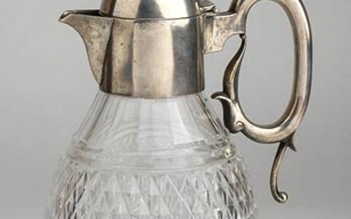 An English cut glass pitcher with sterling silver top -...