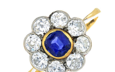 An early 20th century 18ct gold cushion-shape sapphire and vari-cut diamond floral cluster ring.