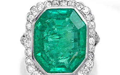An emerald, diamond, and platinum ring designed as an...