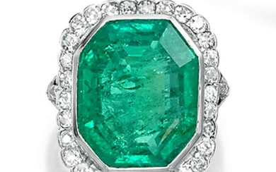 An emerald, diamond, and platinum ring