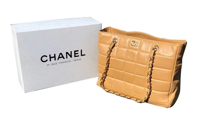 CHANEL, Quilted gold leather shoulder bag, double chain...