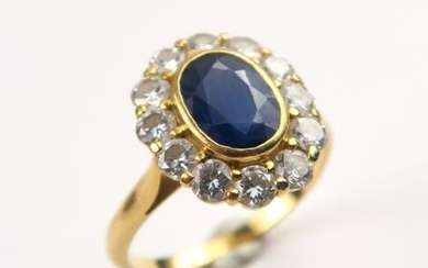 Daisy ring, sapphire set in a diamond setting.