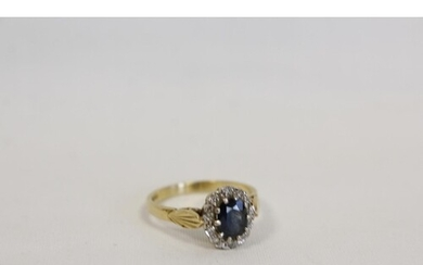 Diamond and sapphire oval cluster ring with eight cut brilli...