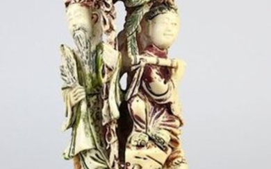 Four figures under a tree, group of figures made of ivory, China c. 1930, carved in one piece in openwork design and partially painted red, green and black, flute player, scholar with scrolls, lady with fan and gentleman with palm leaf, middle piece...
