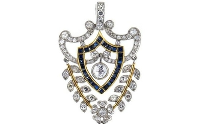 Gold pendant with diamonds and sapphires