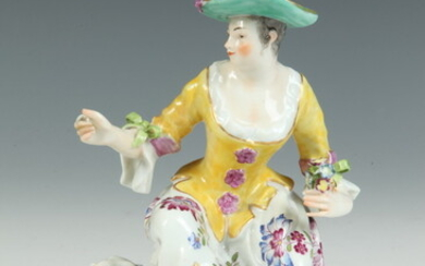 MEISSEN POLYCHROMED PORCELAIN FIGURE MODELED AS SEATED MAIDEN WITH SHEEP,...
