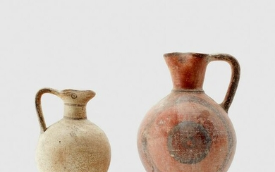 PAIR OF CYPRIOT VESSELS CYPRUS, IRON AGE, C. 700 B.C.
